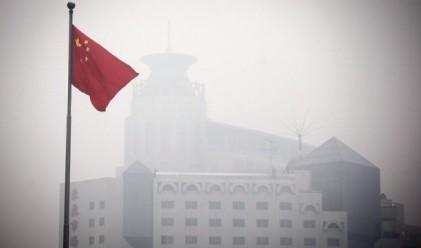 Пекин е блокиран от смог (снимки)
