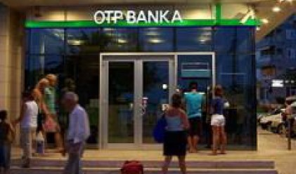 Groupama Buys OTP's Insurance Business, Stake in Bank