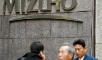 Печалбата на Mizuho пада с 50% през последната финансова година