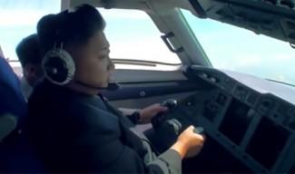 Ким Чен Ун пилотира самолет (снимки)