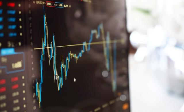 Силните икономически данни от САЩ и Китай доближиха акциите до нови рекорди