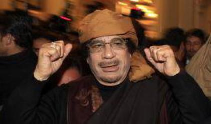 Парите на Кадафи се оказаха в големите световните банки