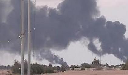 Удариха резиденцията на Кадафи