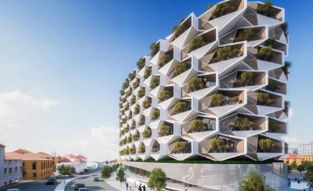 Сграда във формата на медна пита и дървета на балкона