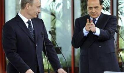 Путин и Берлускони си купуват остров