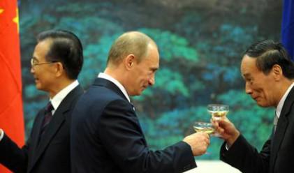 Китай и Русия подписаха сделки за 7 млрд. долара