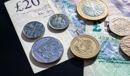 Стойността на британския паунд падна под 1.23 долара