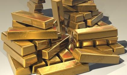 Златото с колебливо представяне днес при силен долар